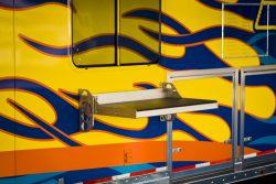 Flip bench installed on outside of trailer