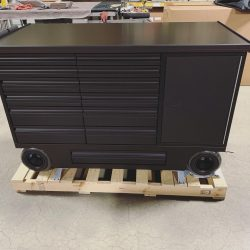 Black anodized 12 drawer pit cart with belly drawer.